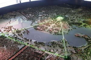 A model of Canberra with the Parliamentary Triangle shown by the green lasers.
